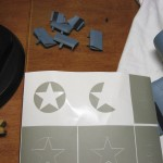 I utilized the scraps from around the star for painting the horizontal bar, as they're the same radius as the roundel.