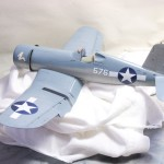Here she is gloss-coated, decals applied (numbers and nose art), waiting for the detail wash.