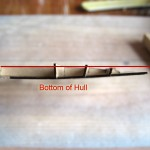 The red line is where the top of the hull bottom (is that confusing?) is supposed to be.  Nearly flat.  The wood warped when I soaked the bottom portion to glue it.