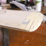 4. The hull has a complex three-axis curve as it moves downwards towards the stern, and downward from the centerline.  At least four applications of putty and sanding gave me a really good shape.  Small imperfections are not an issue, as the entire hull will be sheeted with styrene.