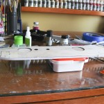 4. The styrene along the forward part of the hull has been glued in, then cut and sanded to shape.  The after hull has the styrene glued on, but not yet cut and sanded.
