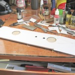 "The curved section of the forward hull required it be sheeted separate from the rest of the main deck.  Here .015"" styrene has been fit to the inner curve, glued to the hull with overlap to allow for any slop in fit."