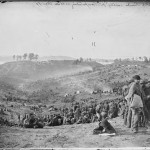 Belle Plaine camp in background, Confederate prisoners in foreground.